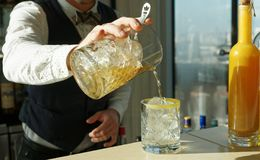 Mixologist is making cocktail on rocks Stock Images