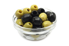 A mixture of black and green olives glass dish Stock Photos