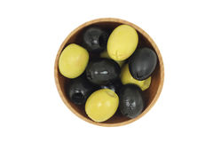 A mixture of black and green olives wooden dish Royalty Free Stock Image