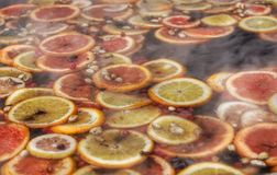 Mixture of citrus in a hot drink royalty free stock photos