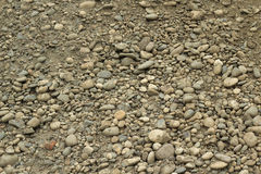 A mixture of clay and sand stones background Stock Photo