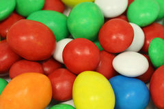 A mixture of colored chocolate candy in glaze Stock Photo