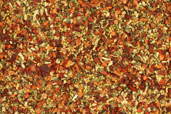 A mixture of crushed spices and vegetables  background Royalty Free Stock Photo