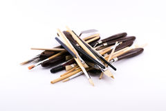 Mixture of different kinds and sizes of brushes and spatula on a white background Stock Image