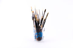 Mixture of different kinds and sizes of brushes and spatula on a white background Stock Photo