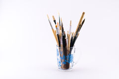 Mixture of different kinds and sizes of brushes and spatula on a white background Stock Photos