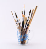 Mixture of different kinds and sizes of brushes on a white background Stock Images