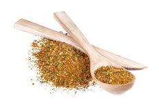 A mixture of different spices. In wooden spoon with wooden knife Stock Photo