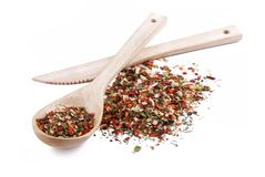 A mixture of different spices. In wooden spoon with wooden knife Royalty Free Stock Image
