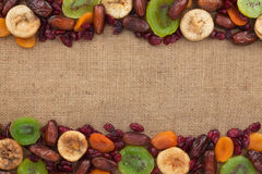 Mixture of dried fruits lying on sackcloth Royalty Free Stock Photos