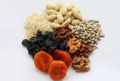 A mixture of dried fruits and nuts. On a white background Stock Photo