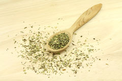 A mixture of dried herbs in a wooden spoon Stock Images