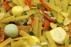 A mixture of dry noodles and vegetables. Close-up Stock Photo
