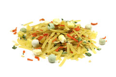 A mixture of dry noodles with vegetables. On a white background Stock Photography