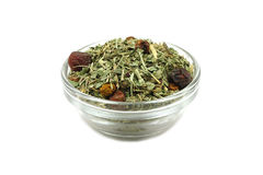A mixture of herbs and berries in a glass cup Stock Photo