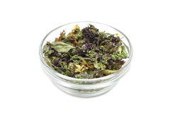 A mixture of herbs in a cup of glass Royalty Free Stock Photo