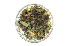A mixture of herbs in a glass container. On a white background stock photos