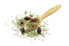 Mixture of herbs in a wooden spoon Stock Images