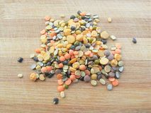 Mixture of lentils heap on wooden background Stock Images