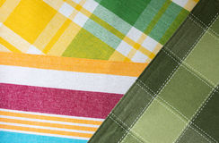 Mixture of multicoloured striped and checkered textile. Royalty Free Stock Photography