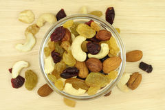 A mixture of nuts and fruit in a glass dish Stock Photos