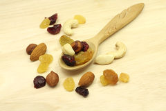 A mixture of nuts and fruits in spoon stock photos