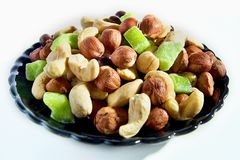 Mixture of nuts. Hazelnuts, cashew and lime Royalty Free Stock Images