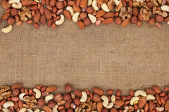 Mixture of nuts lying on sackcloth Royalty Free Stock Photography