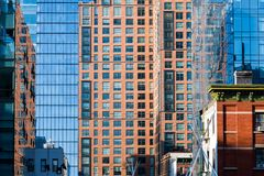 Cityscape of a contrasting combination of old and modern buildings constructed in steel, glass, and brick royalty free stock images