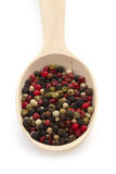 Mixture pepper in wooden spoon on white background Royalty Free Stock Images
