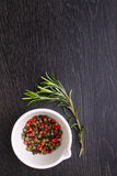 A mixture of peppers ( red, black , white ) Stock Images