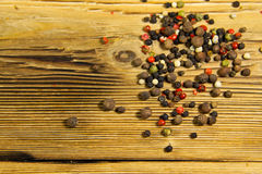 Mixture of peppers spice on wooden table Royalty Free Stock Photo
