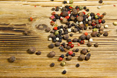 Mixture of peppers spice on wooden table Stock Photography