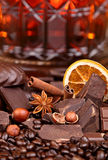 Mixture of pieces of chocolate spices and nuts , selective focus Royalty Free Stock Photos