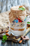 Mixture for the preparation of cookies in a glass jar. Royalty Free Stock Images