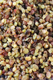 Mixture of raisins of different shades. Mixture of different varieties of raisins on the counter of the bazaar, background Stock Photography