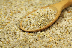 A mixture of salt and herbs in a wooden spoon abstract Royalty Free Stock Photos