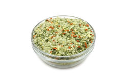 A mixture of salt and vegetables in a glass container Royalty Free Stock Images