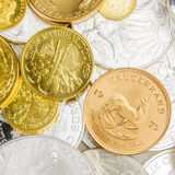 Mixture of silver and golden coins. With different nominal value and size Royalty Free Stock Photos