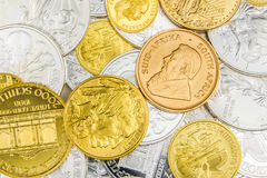 Mixture of silver and golden coins Stock Photos