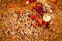 A mixture of spices in a glass jar shot close-up on a white background royalty free stock images