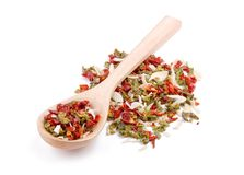 Mixture of spices in wooden spoon Stock Photos