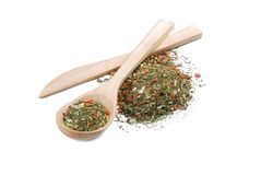 Mixture of spices in wooden spoon Royalty Free Stock Photo