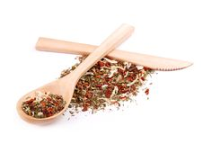 Mixture of spices in wooden spoon with wooden knife Stock Photo