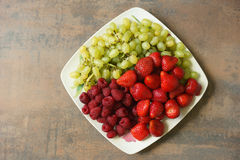 Mixture of strawberries, raspberries and grapes Stock Photography