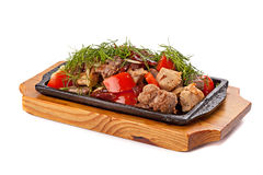 A mixture of various roasted meat with vegetables and herbs serv Royalty Free Stock Images