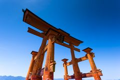 Miyajima, Famous big Shinto torii standing in the ocean in Hiroshima, Japan Royalty Free Stock Photo