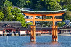 Miyajima, Famous big Shinto torii standing in the ocean in Hiroshima, Japan Stock Photos