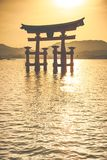 Miyajima, Famous big Shinto torii standing in the ocean in Hiroshima, Japan Royalty Free Stock Image