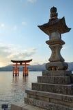 Miyajima Island. Gate (torii) and stone lantern of the Itsukushima Shrine on Miyajima Island across the bay from Hiroshima in Japan stock photography